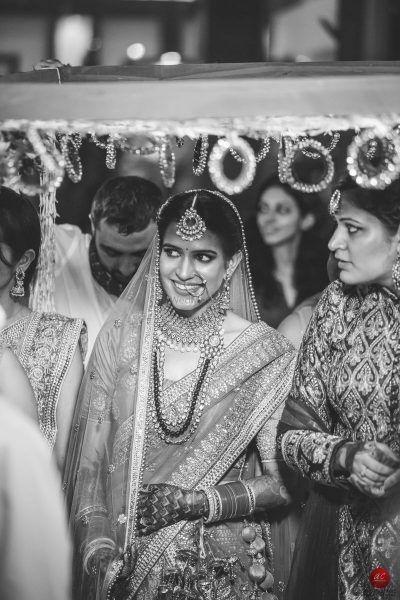 Destination wedding planner, wedding planners, Destination Weddings India, Destination Wedding, Destination Weddings, wedding in Udaipur,Best wedding planner in Udaipur, Best wedding planner at Udaipur, Best wedding planner in Rajasthan, Destination Wedding Planner In India, Best Destination Wedding Planners In India, Phoolon Ki Chadar Ideas, Phoolon ki chadar style, Unique phoolon ki chadar, Phoolon ki chadar leheriya dupatta, Fairy lights chadar, Phoolon ki chadar with red roses, Phoolon ki chadar umbrella style, Hanging Bangles and kalire, Tassels and pom-pom, Tassels on dupatta